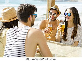 Friends at the beach bar