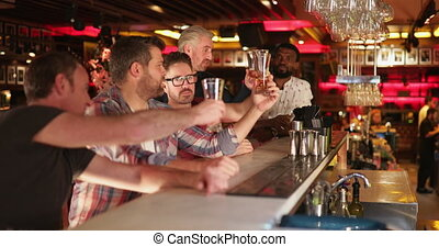 Friends Beer Tasting - Small group of mid adult male friends...