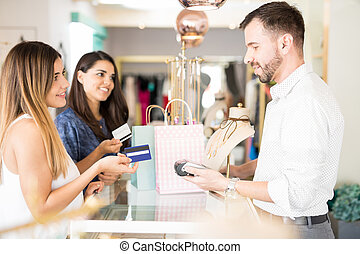 Friends buying jewelry with credit card