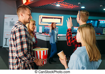 Friends buying tickets in cinema box office - Group of...