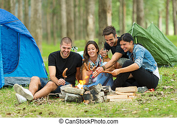 Friends camping in forest