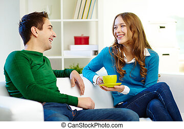 Portrait of joyful friends looking at one another while chatting