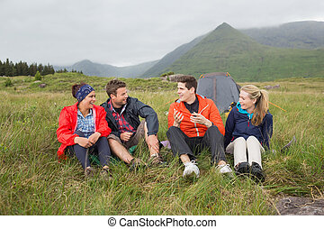Friends chatting together on a camping trip