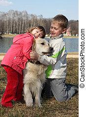 friends - children with retriever outdoor