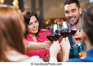 friends clinking glasses of wine at restaurant - leisure,...
