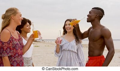 friends clinking non alcoholic drinks on beach - party,...