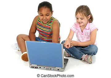 Friends Computer - Two seven year old girls with laptop...