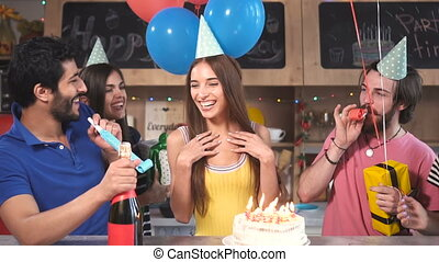 Friends Congratulate Birthday Girl - Smiling friends giving...