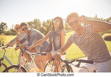 Friends cycling in park