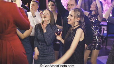 Friends dancing at a party, girls having a night out