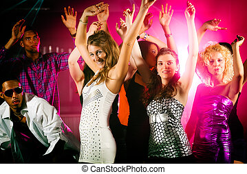 Friends dancing in club or disco - Dance action in a disco ...