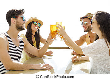 Friends drinking a cold beer