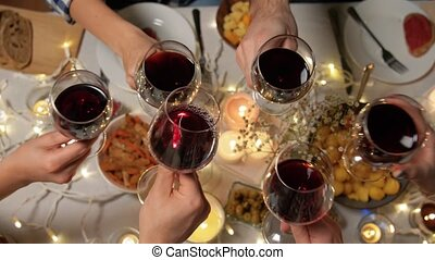 friends drinking red wine at christmas party - holidays, ...