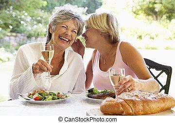 Friends Eating An Al Fresco Meal