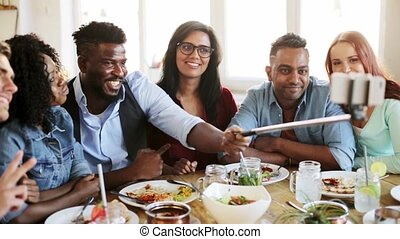 friends eating and taking selfie at restaurant - leisure,...