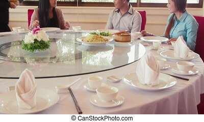 Friends eating at asian restaurant
