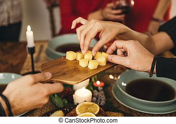 friends eating cheese christmas. High quality and resolution beautiful photo concept