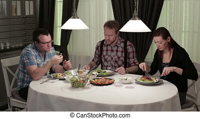 Friends eating in the cafe at the table