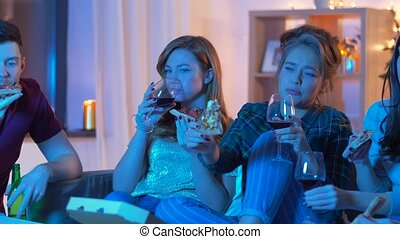 friends eating pizza and drinking wine at home - friendship,...