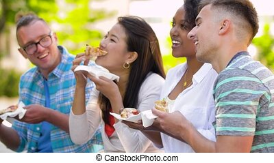 friends eating pizza, sandwich or burger in park - people,...