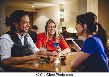 Friends Enjoying Cocktails