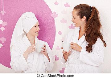 Friends enjoying coffee at a cosmetics studio