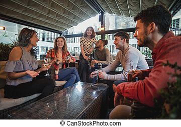 Friends Enjoying Drinks Together