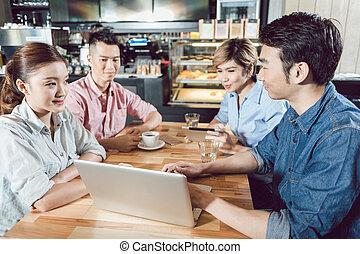 Friends enjoying in the coffee shop