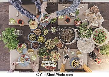 Friends enjoying new vegetarian recipes