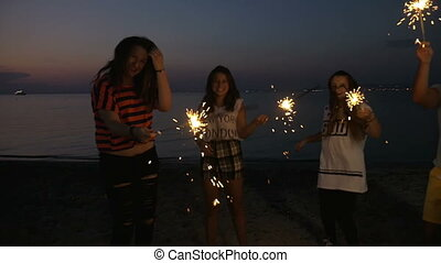 Friends enjoying New Year party at the seaside
