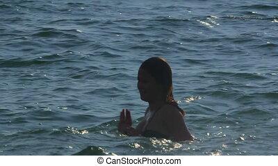Friends enjoying summer beach vacation splashing in water