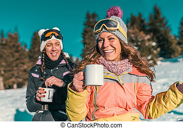 Friends enjoying the winter day on mountain
