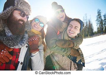 Friends enjoying winter holidays together