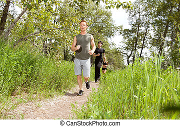 Friends exercising in forest track
