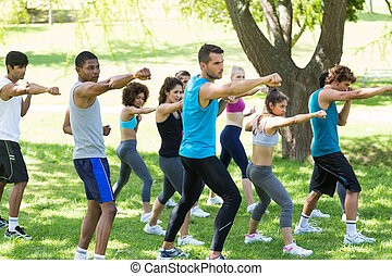 Friends exercising in park