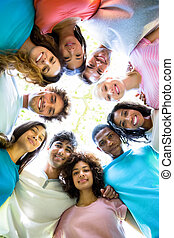 Friends forming huddle - Low angle portrait of confident ...