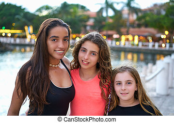 Friends girls portrait at sunset with lights