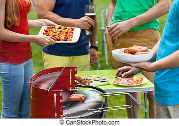 Friends grilling in a garden