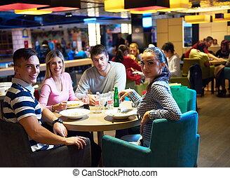 friends have lunch break in shopping mall, eating italian...