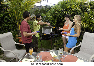 friends having a barbecue party - friends enjoying a...