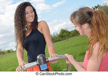 friends having a break from training outdoors