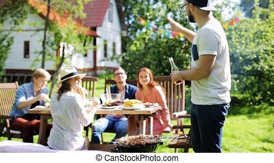 friends having barbecue party at summer garden