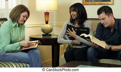 A Bible study group discusses what they are reading from the scriptures.