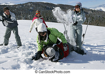 Friends having fun in snow