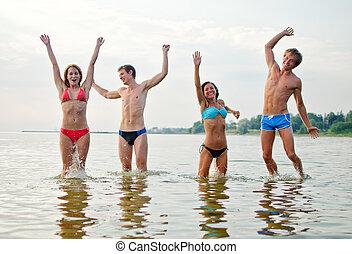 Friends having fun in the sea