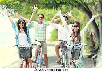 friends having fun riding bicycle together