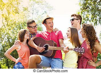 Friends having fun with guitar