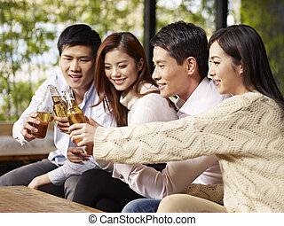 friends having good time - young asian friends gathering...