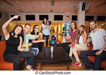 Friends Having Leisure Time in Bowling Club - Portrait of...