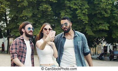 Friends Having Video Chat Outdoors